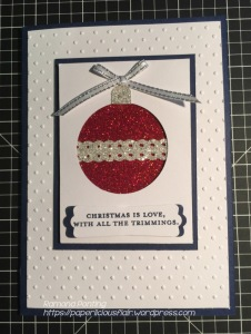A beautiful use of classic Navy and White coloured card stock and glitter paper.